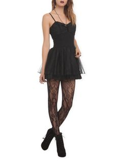 Black dress with a ruched corset top and tulle accented skirt.