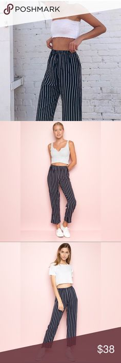 New brandy Melville frankie pants Brand new Frankie pants  high-rise flowy pants in navy blue with thin light blue parallel stripes and elasticized waistband. Brandy Melville Pants Trousers