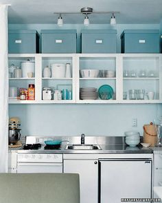 Beautiful space. You could tear apart the usefulness of the design, but it's nice, especially the wall color and oversized storage boxes above the open cabinets. Image from Martha Stewart can be found on their site.