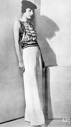 "les-modes: "" Yacht pyjamas by Molyneux, Les Modes June 1934. Photo by d'Ora. "" boat themed novelty print shirt top blouse wide leg pants tam hat summer casual sportswear resort mid 30s era photo"