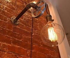 Add a little industrial personality to your home by lighting it up using this pulley wall light. This unique lighting fixture features a vintage Edison bulb that gives off an old school flair while the pulley system allows you to customize the hanging height of the light.