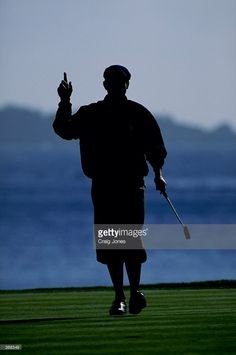 A silhouetted Payne Stewart signals as he walks on the green during the AT&T Pebble Beach National Pro-Am tournament in Pebble Beach, California. Mandatory Credit: Craig Jones /Allsport Get premium, high resolution news photos at Getty Images Golf 7 R, Play Golf, Golf Knickers, Craig Jones, Green News, Club Face, In The Hole, Golf Lessons, Sports Figures