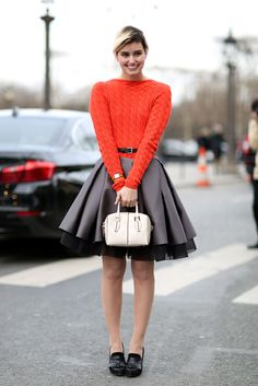 How To Dress Like A French Girl #refinery29  http://www.refinery29.com/63682#slide-37  Balance out a super-feminine skirt with knock-around loafers and an everyday cable knit.