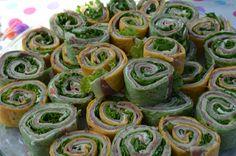 Spinach & Tomato Jalepeno pinwheel sandwiches w/salami, leafy lettuce, Sargento ultra thin cheese, garden vegetable cream cheese.