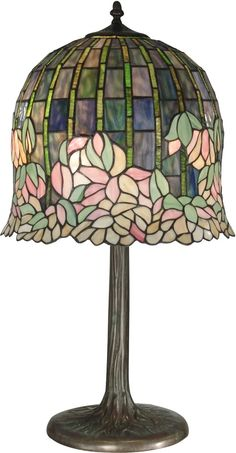 Dale Tiffany is a world-renowned manufacturer of fine glass lighting and home decor in the tradition of Louis Comfort Tiffany. This gorgeous Flowering Lotus Tiffany Table Lamp in Antique Bronze and co