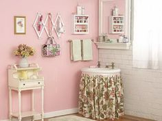 Make the most of a small bathroom with creative storage ideas. Repurpose an accordion coat hanger to organize appliances, cosmetic bags, and jewelry. If you have a pedestal sink, add a skirt and use the extra hidden spac Bathroom Storage Solutions, Small Bathroom Storage, Bathroom Organization, Narrow Shelves, Creative Storage, Storage Ideas, Cheap Bathrooms, Pink Bathrooms, Girly
