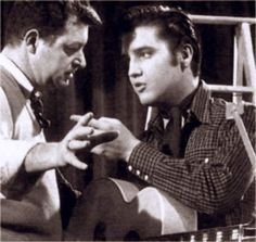Elvis receiving instruction between takes on the set of the movie Loving you winter 1957.