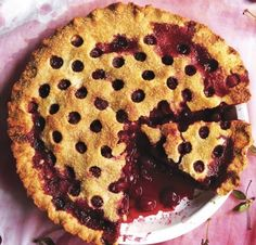 Cutting out the first slice from a juicy cherry pie. | 27 Glorious Food Moments You Need To Experience This Summer