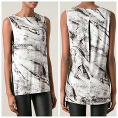 """Marbled Layered Slit Back Tunic Gorgeous tunic with a built in bra coverlet (can easily hide your bra, but is not an actual bra). Dropped armhole, layers, black and white marble pattern. Material is 96% Viscose, 4% Elastane. Excellent gently used condition.   Bust: 30"""" Length: 28.5"""" Helmut Lang Tops Tunics"""