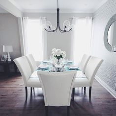 Finished up the Vista dining room in Kanata last week by adding this wallpaper and beautiful mirror! Light fixture by @west elm #fernbankcrossing