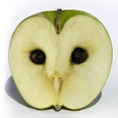 Apple Owl by Ossowski: Finding owl eyes at the core of an apple makes the seeds seem not so bad! Owl art by Ossowski.