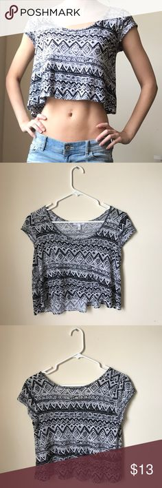 dELiA's Black and White Crop Top Size XS, dELiA's black and white patterned crop top in excellent condition. 100% rayon. Tag states dry clean only but I have machine washed it on delicate once and it turned out fine. dELiA's Tops Crop Tops