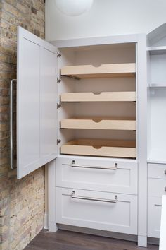 Pull-out pantry doors with white cabinets and bar handle hardware. What's not to love here!!