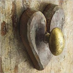 Old door with heart and brass doorknob - great little detail #hardware #architecture #wood #metal