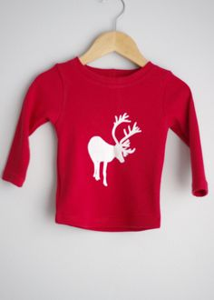 Le chouchou de ma boutique https://www.etsy.com/ca/listing/254365362/red-long-sleeve-reindeer-upcycled-top
