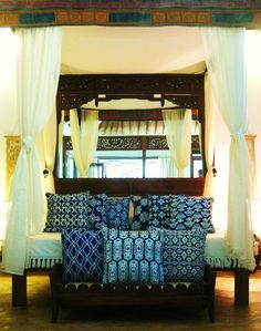 Indigo textiles and an Asian inspired bed, transport this bedroom to Bali.