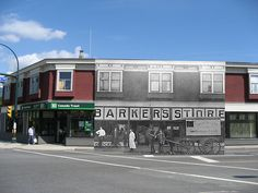 Barker's Store THEN & NOW (c.1913 and 2010) Around 1913, Barker's Store was in the Fromme Block where the TD Bank is now at the corner of Lynn Valley Road and Mountain Highway. George Barker is standing at left. Residents would come here to pick up mail and upstairs was the doctor's office. Created by Conor McCarthy NVMA 12464 / Photo 1449739 Canada Trust, Then And Now Photos, Valley Road, North Vancouver, British Columbia, North West, Street View, Rock, History