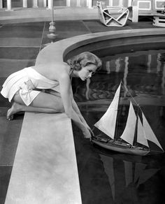 grace kelly with the model of True Love in High Society. True Love is a beautiful song in the movie that was sung at our wedding. Love that she wore her own engagement ring while filming the movie and that her own wedding dress was created by the movie's costume designer.