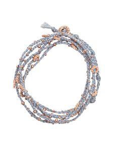wrap it up with a handmade light blue + rose gold bracelet