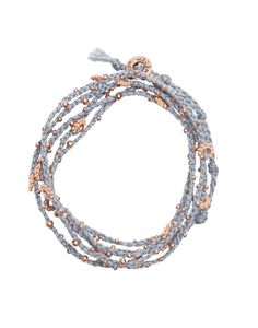 wrap it up with a handmade light blue + rose gold bracelet