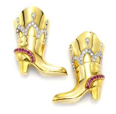 A Pair of Gold, Diamond and Ruby Boot Brooches, circa 1945.   Available at FD. www.fd-inspired.com