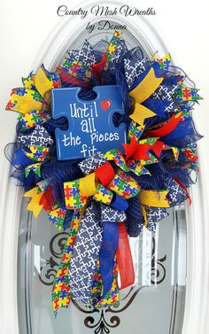 "Autism Awareness Wreath Navy Deco Mesh on 10"" Work Wreath.  Assorted Autism ribbons, with Custom painted sign."