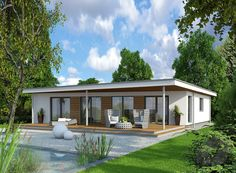 VARIO-HAUS manufactures and distributes first class prefabricated house, especially low energy and passive homes. VARIO-HAUS gives your life a home. Bungalow Floor Plans, Modern Bungalow House, Coastal House Plans, Small House Plans, Future House, Flat Roof House Designs, Beautiful Small Homes, Modern Courtyard, Backyard Cottage