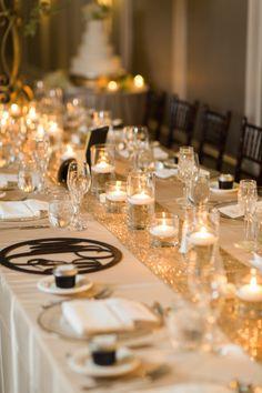 Gold wedding reception theme with candle wedding centerpiece; photo: Graham Terhune