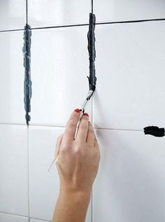 How to DIY dye your white grout black! Such an easy DIY that can completely transform your bathroom or kitchen -- and no more dirty grout! Get inspired to make your own bathroom makeover happen with the tips and ideas from Bathroom Renovations, Home Renovation, Home Remodeling, Bathroom Makeovers, Cheap Bathroom Makeover, Easy Bathroom Updates, Kitchen Remodeling, Home Improvement Projects, Home Projects