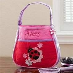 Personalized Girl's Ladybug Purse & Coin Purse Set by PersonalizationMall.com. $28.95. Our Personalized Ladybug Purse will feature her name embroidered in red for all to see!Perfect for play or running errands with Mommy, Now she can be just like one of the big girls with her coordinating and stylish purse set!Makes a great gift set for birthdays, flower girls, holidays and much more! Quality constructed 100% cotton/poly quilted twill outer shell with washable nylon lining, zipp...
