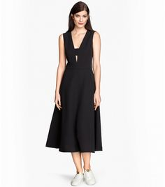 H&M Dress with Circle Skirt in black with low-cut neckline at front with cut-out section