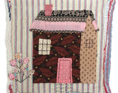 This original textile picture is unframed but mounted and is made by me in my studio in a converted manse in rural Northumberland in the north of England. I love old fabrics, patchwork quilts, folk art, stitching and making things with my hands so these pictures bring all the interests together. The support for the piece is a very old piece of log cabin quilt. I have used the back of it! I have appliquéd and embroidered on a a little house which I hope captures some of the naiveness that I…