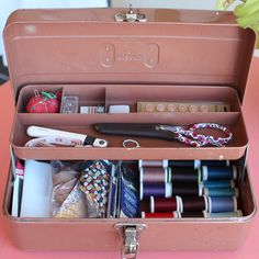 Use a tackle box as a sewing kit. I like this, even a little better than my old train case sewing kit - must keep eyes open for old tackle boxes like this!