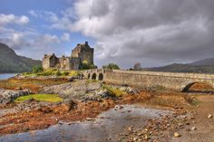 Eilean Castle - Donan, SCOTLAND--- Located on a small island in the western Highlands of Scotland. Eilean Donan castle was built in the 13th century, and was sadly almost completed destroyed in the 18th century. Although not much remained of the once-grand castle, Lt. Col. John MacRae-Gilstrap restored the entire building between 1919 and 1932, paying tribute to the original design