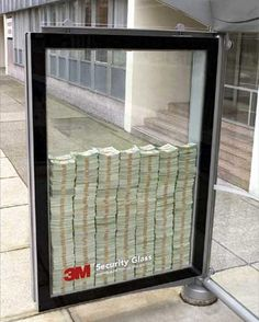 That is real cash behind unbreakable glass.. wow... gutsy advertising