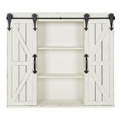 The look of rustic barn doors adds character to Kate and Laurel's Cates Wood Wall Cabinet, ideal for your vintage farmhouse style. The doors slide on the antique-look metal rail to cover either the large center compartment or the 2 side compartments. Rustic Wood Walls, Wall Cabinet, Wall Mounted Shelves, Wall Storage Cabinets, Wall Shelving Units, Rustic Wall Hangings, Wall Mounted Bathroom Cabinets, Wall Hanging Storage, Barn Doors Sliding