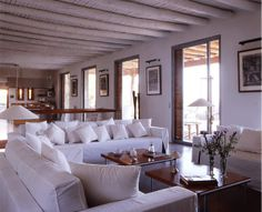 I like all the white, the couches and the ceiling in this living room