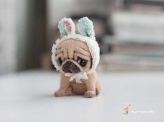Tiny dog.made to order 9 days,needle felted dog.8 cm the pug dog/to the top of the bunny hat is 10 cm is tall.