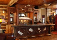 Lodge Bar made with recycled woods, red willow and cow hide.  From Lindley's Cabinets in my hometown of Victor, Montana