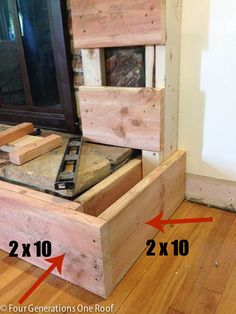DIY fireplace makeover framing around vents + how to frame a hearth