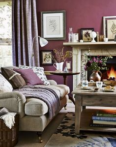 ~Purple country living room with white marble fireplace~ Darker, richer tones of colour create a cosy,welcoming atmosphere to a room. Combine dusky shades of plum, claret and rose to introduce a heritage, sophisticated feel; balance with softer shades of mauve-greys and browns.