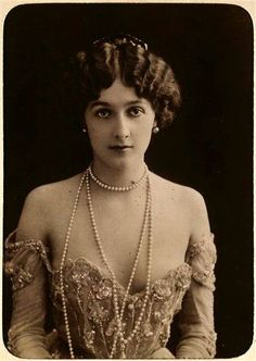 Lina Cavalieri, c1900, She was considered one the most beautiful woman in the world. As a young girl, she ran from the orphanage with a theatre group, made career as vaudeville singer first in Paris and soon all around Europe. In 1900 she debuted as opera singer, soon conquering the operahouses of Monte-Carlo, Paris and New York. She was famous for her hour-glass-like corsets, visible in photographs and portraits by Cesare Tallone and Giovanni Boldini.