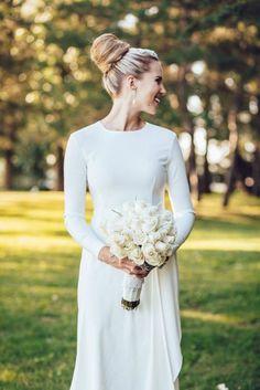Simple minimalist wedding dress with long sleeves #wedding #bride #fashion