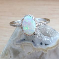 Opal Engagement Ring with Simulated Diamond Halo Sterling Silver Jewelry - AlphaVariable Opal Jewelry, Diamond Jewelry, Diamond Rings, Solitaire Diamond, Birthstone Jewelry, Solitaire Rings, Glass Jewelry, Band Rings, Wooden Jewelry