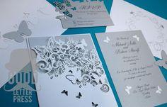 lazer cut wedding invitations | Photo: Laser cut butterfly wedding invitation suite
