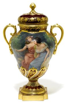 A Vienna style porcelain covered urn late 19th/early 20th century