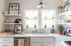 """The kitchen and master bath, which hadn't been remodeled since the '50s, were both gut renovated. """"I had a ball just working with Waterworks and finding really timeless materials like marble and subway tiles, and making everything clean and open and whitewashed,"""" Adams says. """"The renovation project was a blast for me."""""""