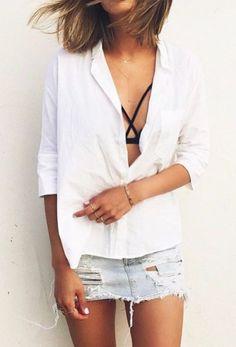 white shirt. denim skirt. straps detail bra.