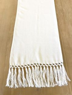 "This lovely Mexican rebozo can be used as a table runner or shawl. Woven by artisans in Mexico, they are made from the softest and best quality materials. The fringed ends add a beautiful bohemain detail to your event or outfit.  Measurements: 13""x82"" including fringes."