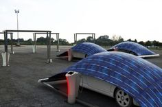 You know you want one...V-Tent is an eco-friendly parking system designed by Hakan Gürsu that protects and charges vehicles.